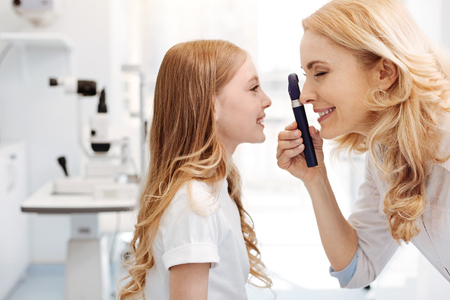 Prominent eye specialist using ophthalmoscope