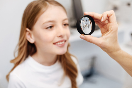 Careful intelligent girl following doctors instructions