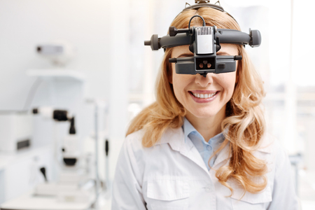 Trained talented ophthalmologist getting used to new equipment Stock Photo