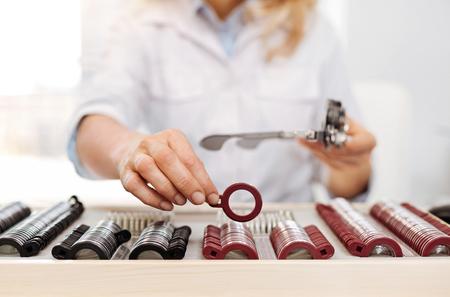 Neat wonderful optician organizing her set of trial lenses