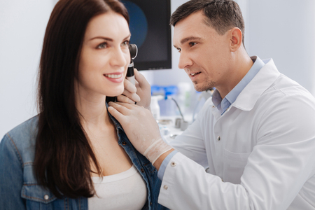 Beautiful female consulting with her otolaryngologist