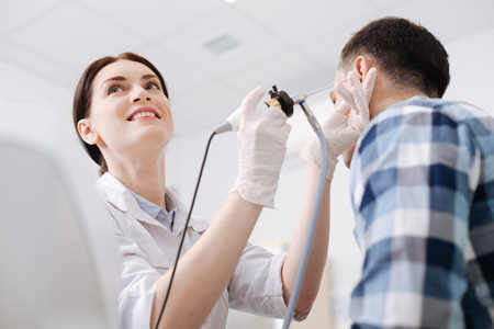 Beautiful doctor rising her eyes up Stock Photo