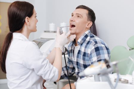 Positive man keeping his mouth opened Stock Photo
