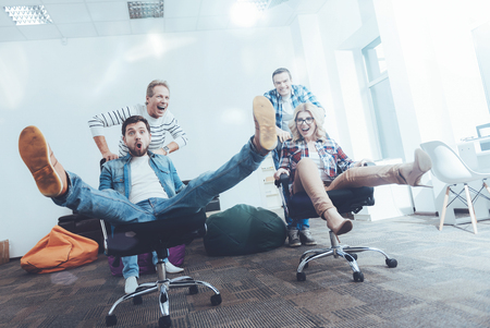 Low angle of cheerful office workers having fun