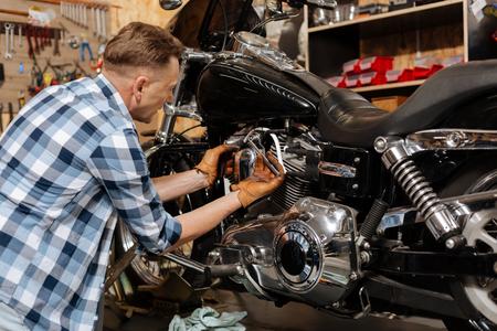 old school bike: Accomplished skillful mechanic fixing his bike