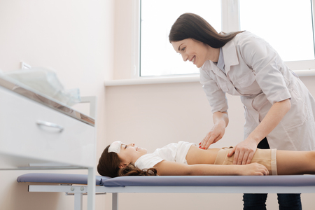 Nice pleasant girl lying on the medical bed