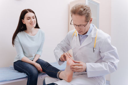 Mindful charismatic expert testing the work of patients joints