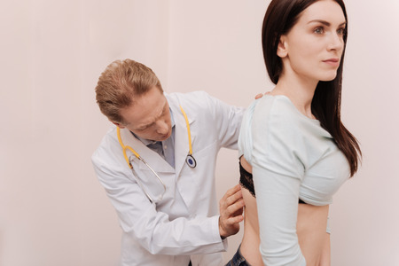 Graceful young woman having her spine checked