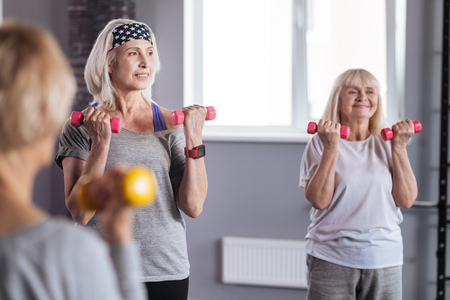 Delighted active women enjoying their fitness workout Stock Photo
