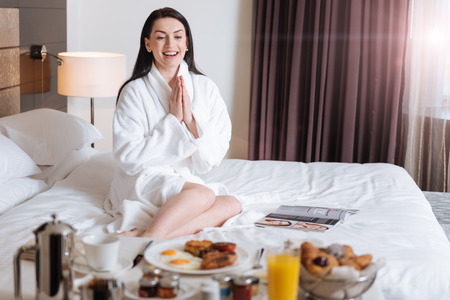 hotel staff: Delighted happy woman looking at her meal