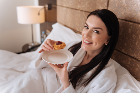 Delighted pretty woman looking at you Stock Photo