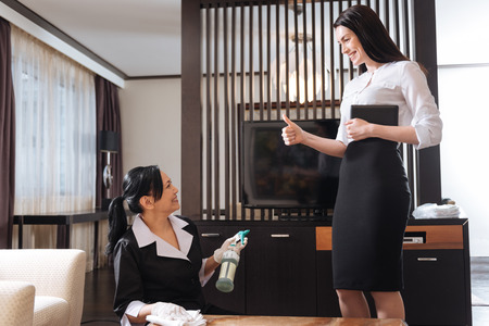hotel staff: Happy delighted manager being satisfied with her maids work