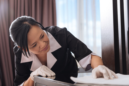 Nice Asian woman cleaning the table Stock Photo
