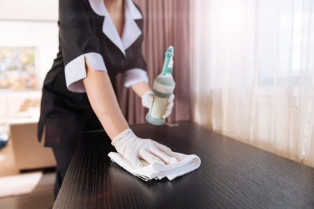 Duster being used by a professional chambermaid