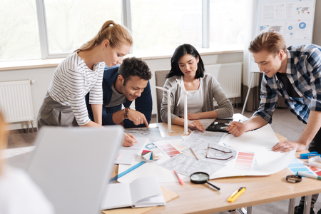 Nice serious engineers being involved in work Stock Photo