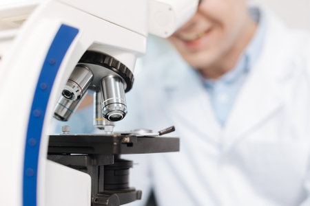 medical laboratory: Close up of four objective lenses while being at work