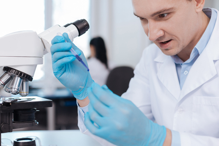 medical laboratory: Portrait of enigmatical scientist while watching at the process
