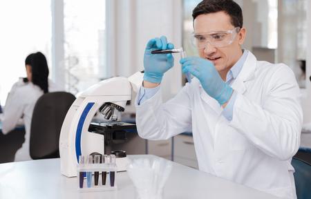 Handsome scientist inventing new formula