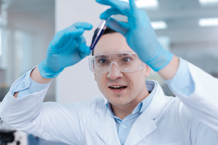 Positive delighted researcher inventing new molecular formula Stock Photo