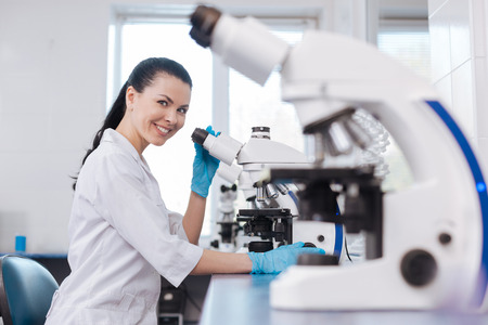 medical laboratory: Positive delighted researcher looking at camera Stock Photo