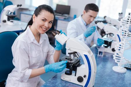genomics: Smiling young professional posing on camera