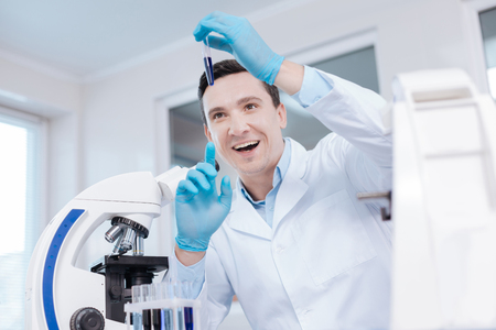 Delighted male person keeping smile on his face