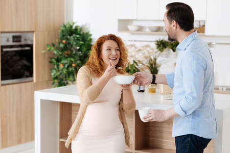 Husband taking care of wife while eating together Stock Photo