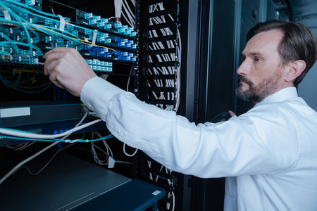 bearded wires: Serious bearded man looking at the internet wires Stock Photo