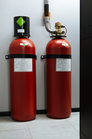 Close up of fire extinguishers standing on the floor