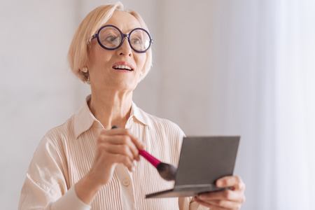 Surprised mature woman looking forward Stock Photo