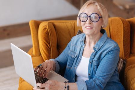 gerontology: Charming missis posing on camera