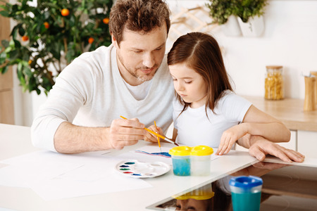 Loving father painting with his daughter