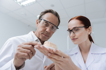 Two interested in science people keeping eyes in safe Stock Photo