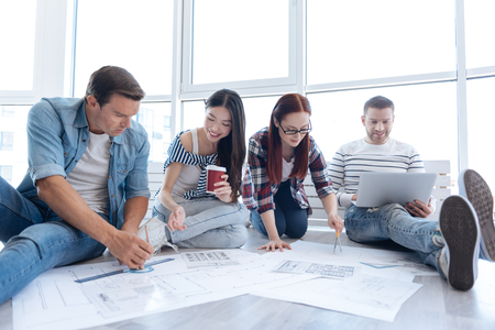 Positive joyful people working in team Stock Photo