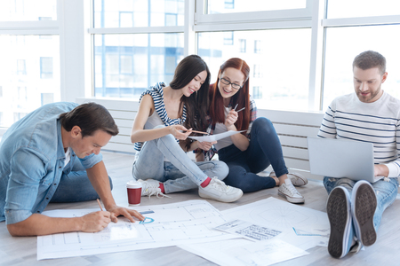 Cheerful female architects discussing their ideas Stock Photo
