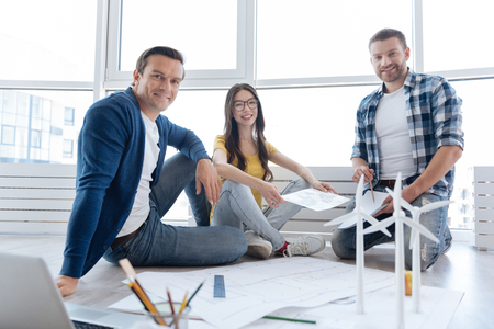 Cheerful nice people looking at you Stock Photo