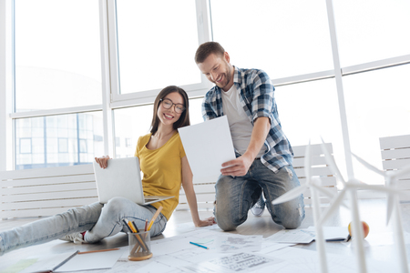 Joyful happy people having business ideas