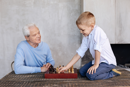 baby boomer: Passionate lively gentleman proud of his grandson Stock Photo