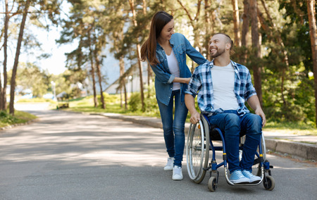 sweethearts: Positive delighted disabled man expressing positivity Stock Photo