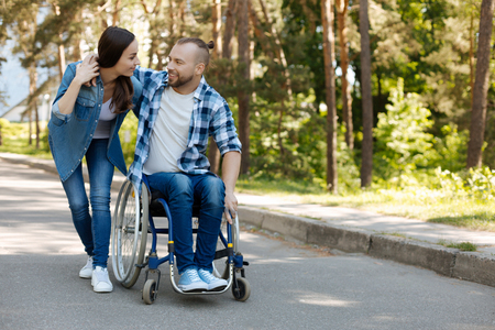 Positive delighted man sitting on the wheelchair Stock Photo