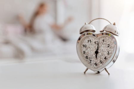 upbringing: White alarm clock ringing in the morning