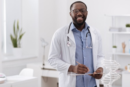Handsome professional doctor looking at you