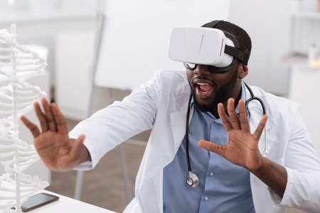 up code: Nice professional doctor using the newest technologies