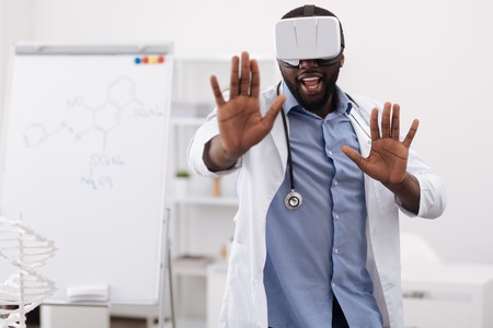 genomics: Handsome professional doctor pressing his hands to the virtual screen Stock Photo