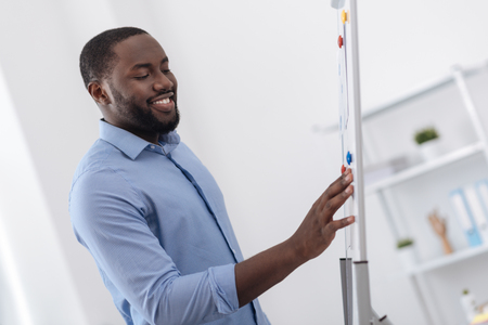 Happy nice man looking at the whiteboard Stock Photo