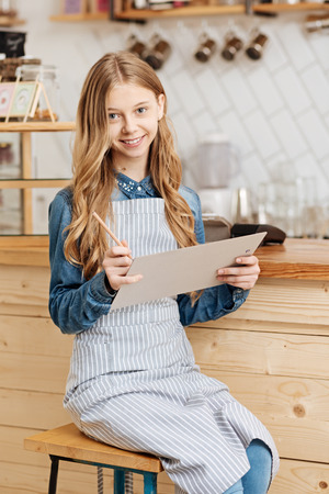 Beautiful fair-haired girl inventing new menu