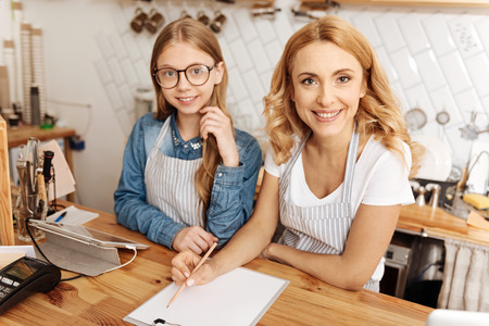 Mother and daughter drafting a business plan for their cafe