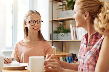 upbringing: Mother and daughter catching up over a cup of coffee
