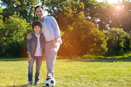 upbringing: Optimistic bright family having a sporty weekend together Stock Photo
