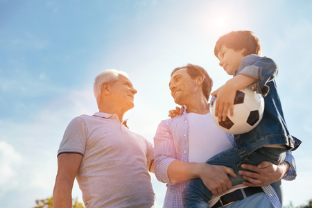 Energetic healthy family gathering for a game